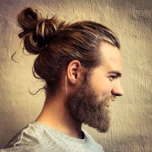 man bun hairstyle for big ears men