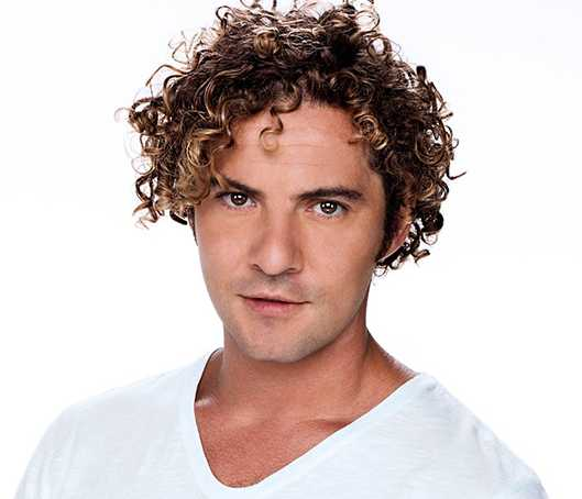 The shake and go hairstyle for curly hair men