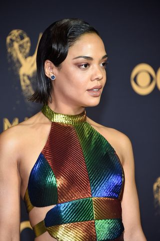 Image result for Tessa Thompson Thompson's wet texture has a glossy shine that's practically blinding. The S-wave swoop in the the front gives this style a timeless, old Hollywood vibe.