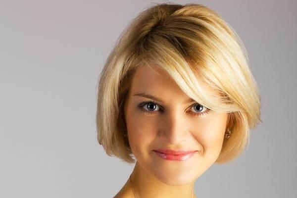 blonde woman sporting a bob